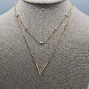 Elegant Gold plated CZ double chain necklace .